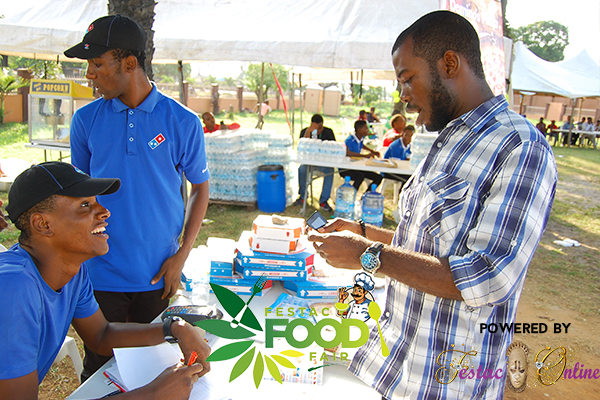 dominos-dishing-out-vouchers-at-festac-food-fair