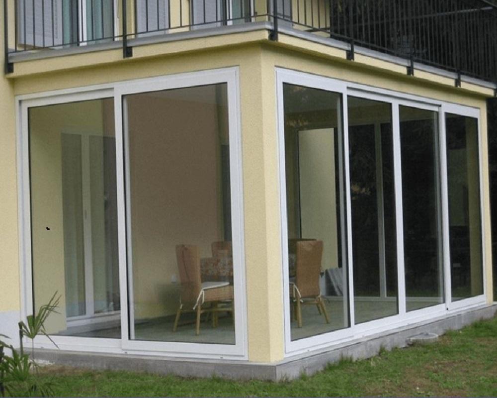 Chiusura terrazzo con vetrate