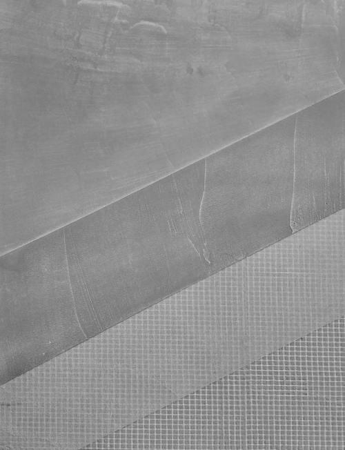 Przekrój przez system mikrocementowy wzmacniany siatką z włókna szklanego