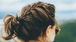 woman-wearing-sunglasses-and-french-braid-bun