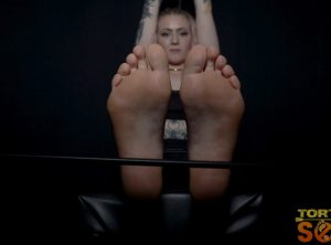 Baby Sid: Her Mona Lisa Smile As Her Soles Are Caned Hard