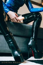 strapon mistress wearing flesh coloured dildo and stiletto boots