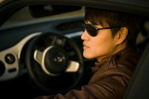A man driving a car