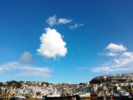 Triangular cumulo nimbus cloud in a blue sky