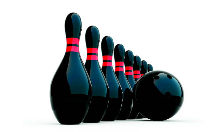 black and shiny bowling ball and pins