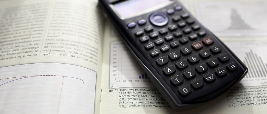 scientific calculator on open book on statistics