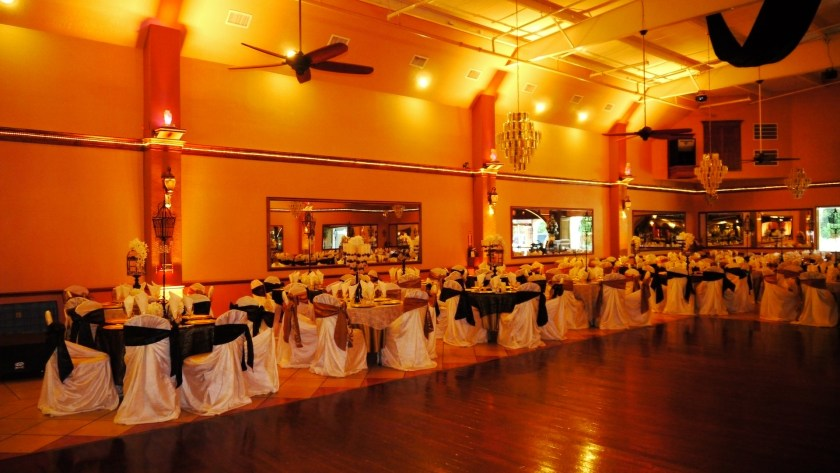 Herreras Reception Hall Amber LED Uplights Full Side Wall From Dance Floor