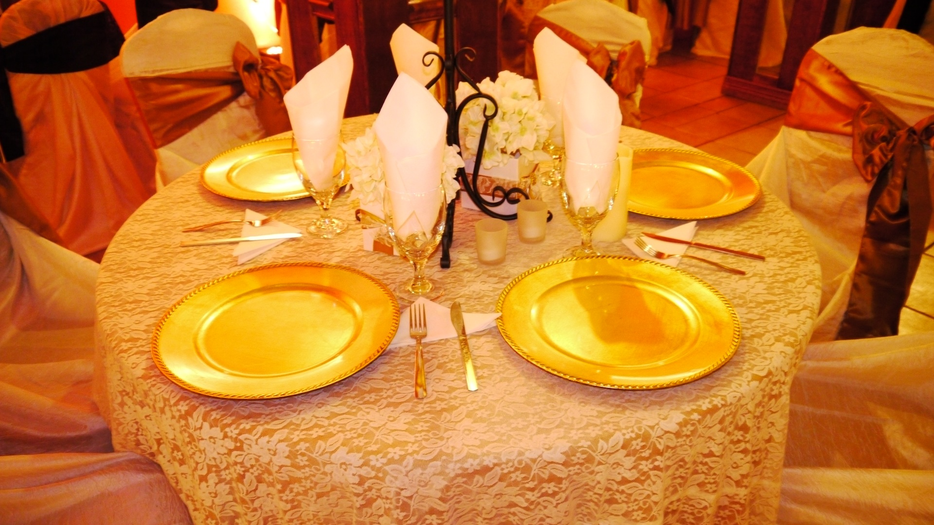 Herreras Reception Hall Amber LED Uplights Table Setting