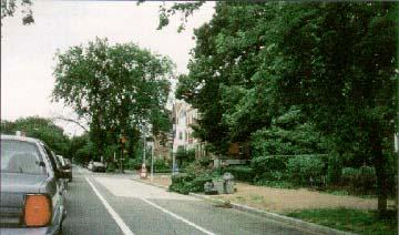photo: East Capitol Street, Washington, DC, showing from left to right: travel lane, bike lane, parking lane