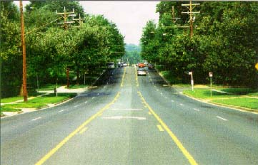 Photo of a five lane street. Middle lane is a twoway leftturn lane.
