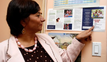 Maha Attieh Points to a Census Poster in her Office - Photo: Sarah Kate Kramer