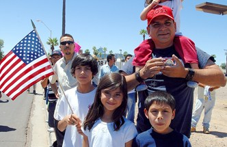 A family at Saturday's protest in Phoenix - Photo: José Muño