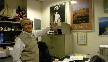 Takis Vassos, owner of Pegasus Travel, a travel agency in Astoria