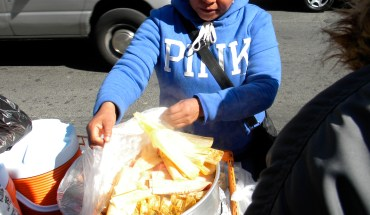 Street vendor selling tamales in Jackson Heights