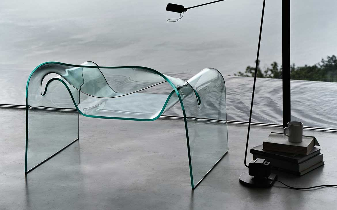Ghost the curved glass chair designed by Cini Boeri