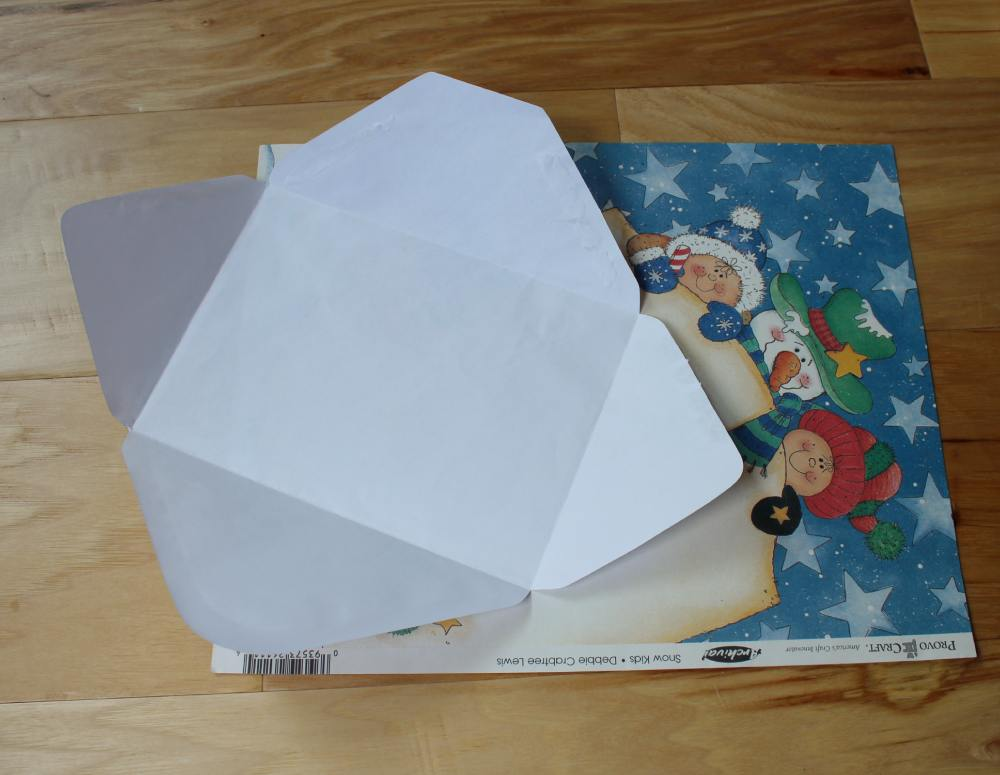 Blank envelope and scrap book paper