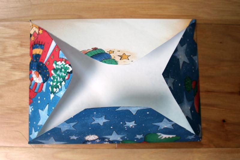 Folded scrap book paper for homemade Christmas envelope