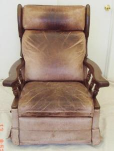 Leather chair darkened from body oil