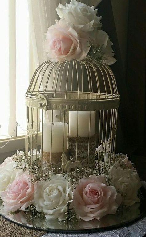Arreglos de Centros de Mesa para Bautizo con jaulas flores y rosas