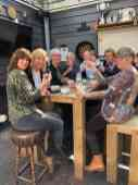 Heerlijk met z'n allen aan de soep (en een wijntje) — bij De Jachthaven Kwintsheul.