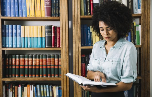 black-woman-reading-book-library_23-2148042693