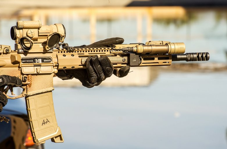 A rifle with a Cerakote finish in Flat Dark Earth.