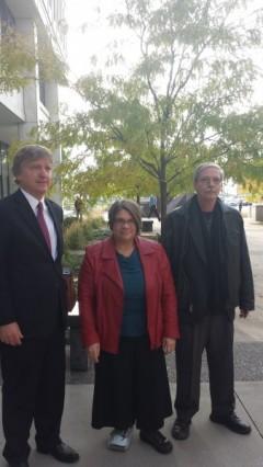 Bruce Nestor, Jess Sundin, and Mick Kelly outside federal court building Nov. 1.