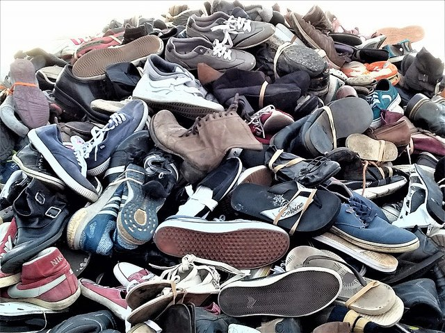 A Pile Of Cheap Shoes For Sale