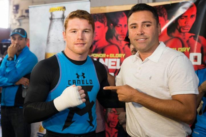 https://i0.wp.com/www.fightweek.com/wp-content/gallery/honor-glory-canelo-alvarez-media-workout-quotes-photos/003_Canelo_and_Oscar_de_la_Hoya.jpg?resize=723%2C482