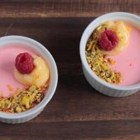 Raspberry possets, lemon curd and  pistachio thins.