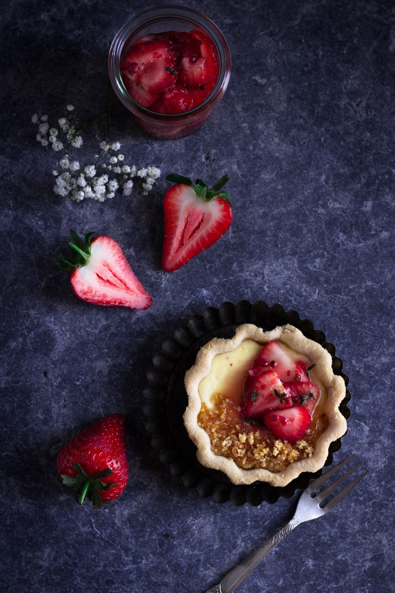 Ricotta tartlets with pink peppercorn macerated strawberries and pine nut brittle