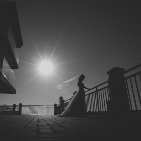 bride on pier with sun