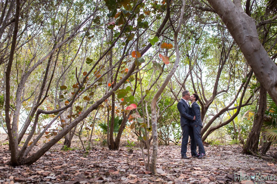 same sex couple in the woods at fort zachary taylor