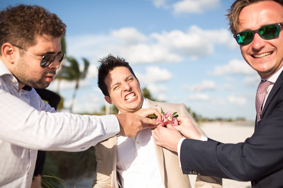 groom and his friends being funny at his smathers beach wedding in key west florida