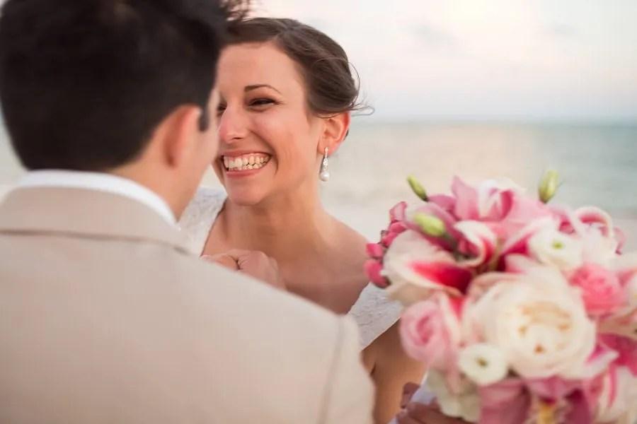 bride and groom having fun on their beach wedding in key west, florida