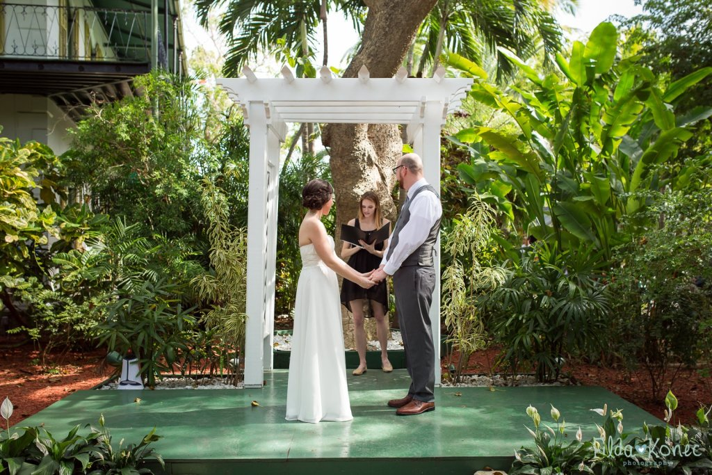 couple during their ceremony at hemingway home in key west