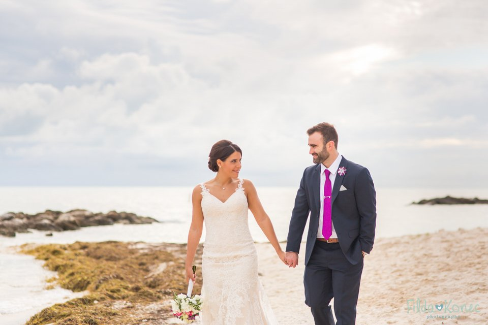 bride and groom walking on the fort zachary beach in key west, florida