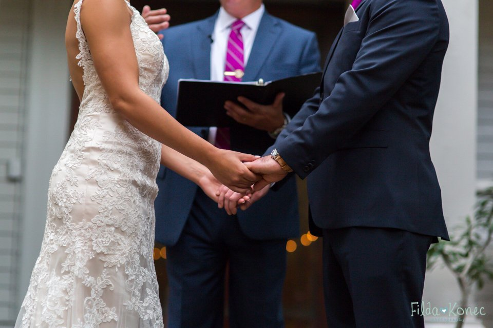 close up photo of bride and groom holding hands