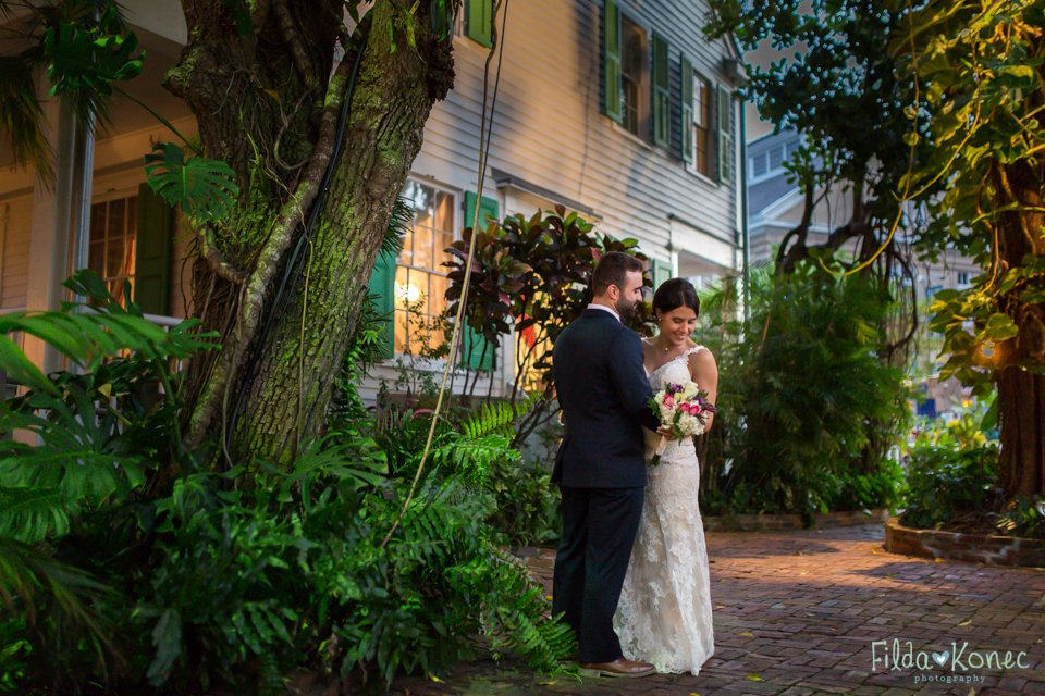 photo of bride and groom in the garden at audubon house in key west, florida