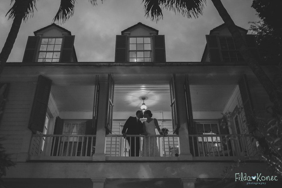 night photo of bride and groom on the balcony