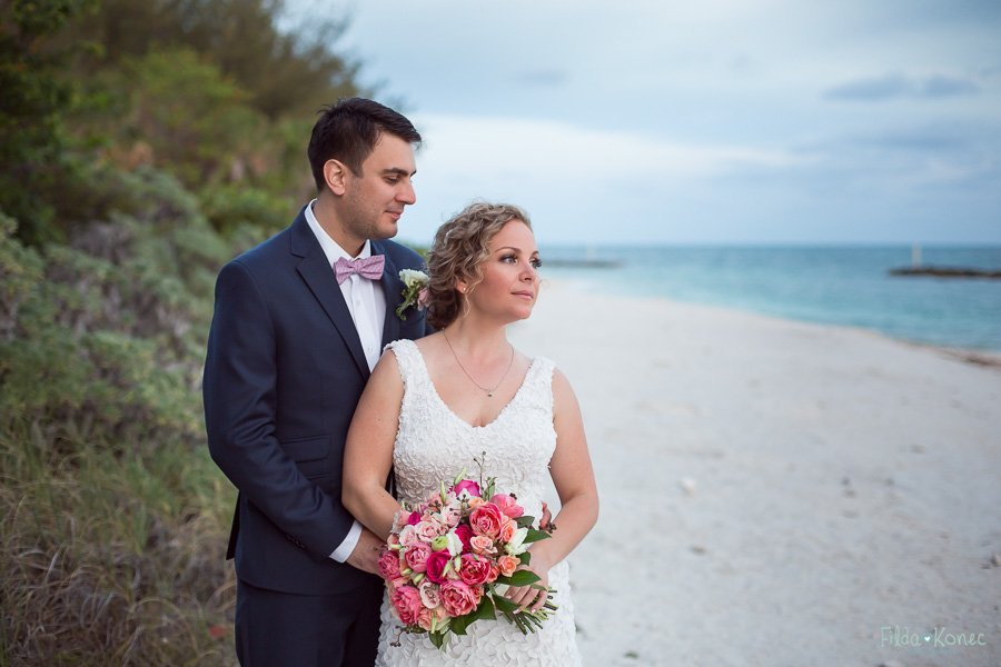 bride and groom in the woods at fort zachary taylor state park in key west florida
