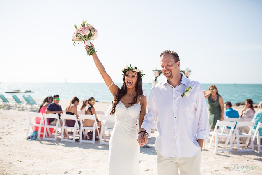 bride is happy to be married on sunset key florida beach