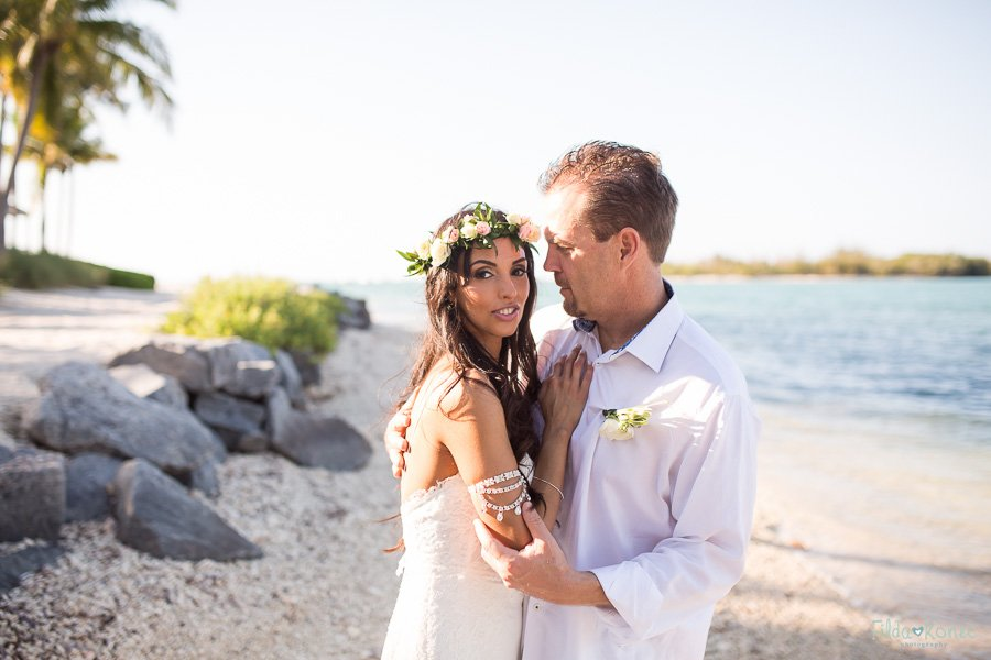 married couple after their wedding near the ocean at sunset key florida