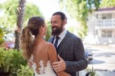 bride and groom in front of their hotel during their first looks