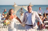 bride and groom walk out the aisle at their key west beach wedding