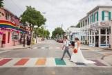 bride and groom at rainbow crosswalk on duval street in key west florida