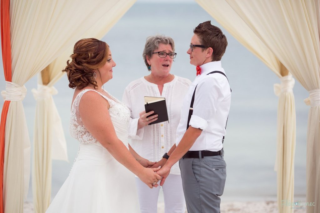 bride and groom at the altar at their beach wedding