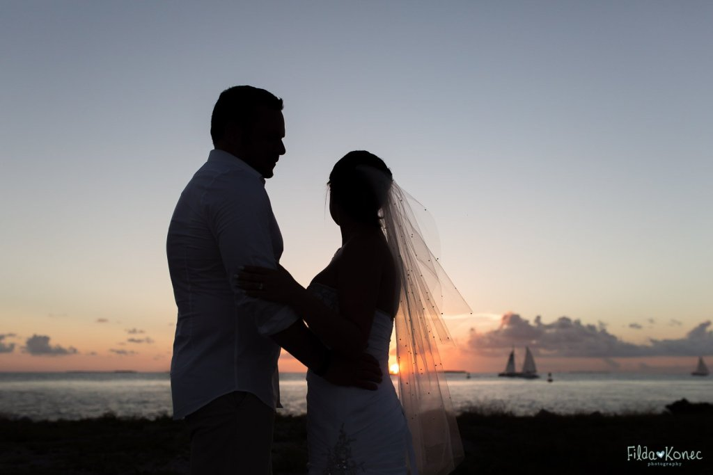 silhouette photo of wedding couple near ocean in key west
