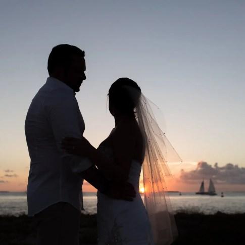 silhouette photo of wedding couple near ocean in key west
