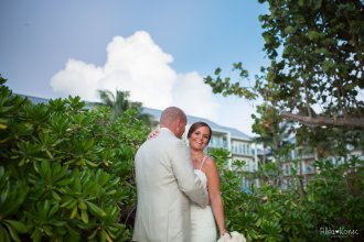 groom hugs his bride at hyatt in key west after their wedding